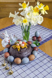 Festive Easter table decorated with flowers, colored eggs and cakes Royalty Free Stock Photography