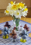 Festive Easter table decorated with flowers, colored eggs and cakes Stock Photos