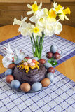 Festive Easter table decorated with flowers, colored eggs and cakes Stock Images