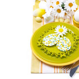Festive Easter table setting with decorations, flowers. And rabbit, top view, isolated on white Stock Image