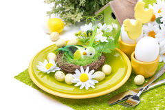 Festive Easter table setting with decorations, flowers, isolated. Festive Easter table setting with decorations and flowers, isolated on white Stock Photo