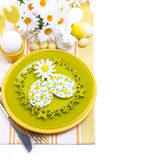 Festive Easter table setting with decorative ornaments, top view. Isolated on white Stock Image