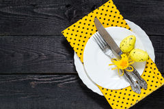 Festive Easter table setting. Plates, knife and fork with ribbon, chicken and egg Royalty Free Stock Photography