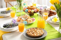 Festive Easter table setting with meal. Festive Easter table setting with traditional meal stock image