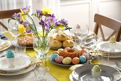 Festive Easter table setting with traditional meal. At home stock images