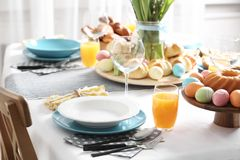 Festive Easter table setting with traditional meal. At home stock photos