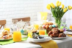 Festive Easter table setting with traditional meal. At home royalty free stock image