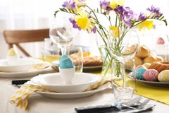 Festive Easter table setting with traditional meal. At home stock photography