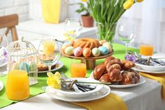 Festive Easter table setting with traditional meal. At home royalty free stock photography