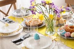 Festive Easter table setting with traditional meal. At home stock photo
