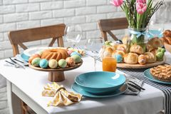 Festive Easter table setting with traditional meal. At home stock image