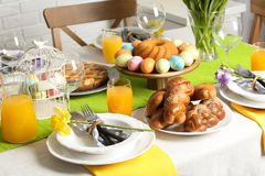 Festive Easter table setting with traditional meal. At home royalty free stock photo