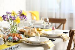Festive Easter table setting with traditional meal at home. Space for text royalty free stock image