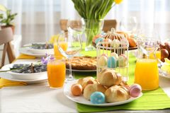 Festive Easter table setting with traditional meal at home. Space for text stock photos