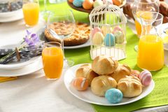 Festive Easter table setting with traditional meal at home. Space for text stock image