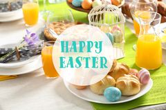 Festive Easter table setting with traditional meal. At home, space for text royalty free stock photo