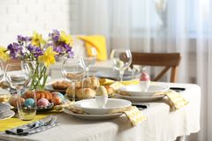 Festive Easter table setting with traditional meal at home. Space for text royalty free stock photos