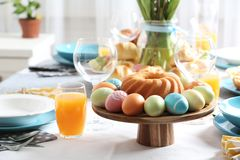 Festive Easter table setting with traditional meal. Space for text stock image