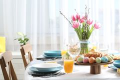 Festive Easter table setting with traditional meal. Space for text royalty free stock image