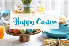Festive Easter table setting with traditional meal. Space for text stock images