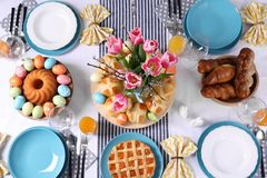 Festive Easter table setting with traditional meal. Top view stock images