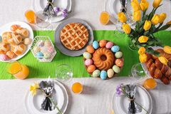 Festive Easter table setting with traditional meal. Top view stock photo