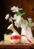 Festive eggs decorated with red ribbon - symbol of Easter Stock Image