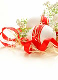 Festive eggs decorated with red ribbon - symbol of Easter Stock Photo