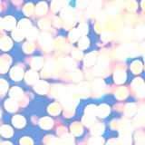 Festive elegant abstract background with bokeh lights and stars Royalty Free Stock Images