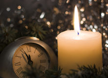 Festive evening candle. Christmas tree fir branches covered with snow. Royalty Free Stock Photography
