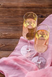 Festive evening with champagne glasses. On wooden table Stock Images
