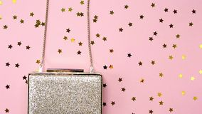 Festive evening golden clutch on pink. Holiday and celebration b stock video