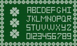 Festive fabric script on emerald green knitted background. White knitted latin letters and numerals framed with clover shamrocks pattern border. Vector signs Stock Photography