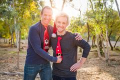 Festive Father and Son Portrait Outdoors. Fun, Handsome Festive Father and Son Portrait Outdoors stock image