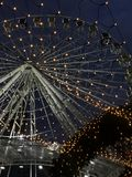 Ferris wheel in the city. Festive ferris wheel in the city in the evening Stock Images