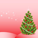 Festive fir-tree on a pink background Stock Image
