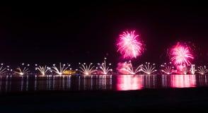 Festive firework over seaside water stock image