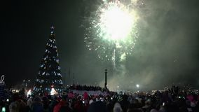 Festive fireworks in honor of happy new year. Crowd of people watching fireworks. Festive fireworks in honor of Happy New Year 2019. Crowd of people watching and stock video footage