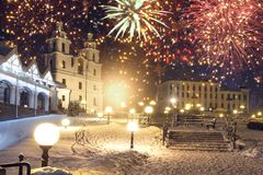 Festive fireworks in night Minsk, Belarus. Beautiful salute over Minsk city. Firework royalty free stock photo