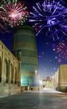 Festive fireworks over an unfinished minaret. Khiva, Uzbekistan Stock Photo