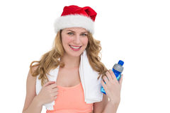 Festive fit blonde holding bottle of water Royalty Free Stock Image