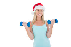 Festive fit blonde holding dumbbells Royalty Free Stock Image