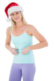 Festive fit blonde pinching her stomach Royalty Free Stock Photo