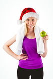 Festive fit blonde smiling at camera holding apple Stock Photography