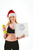 Festive fit blonde smiling at camera Royalty Free Stock Photos