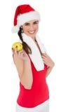 Festive fit brunette holding apple Royalty Free Stock Image
