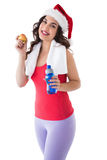 Festive fit brunette holding bottle and apple Royalty Free Stock Images