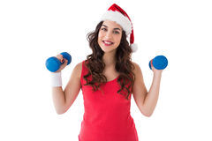 Festive fit brunette holding dumbbells Stock Images