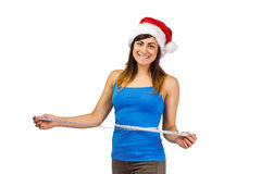 Festive fit brunette measuring her waist Stock Images