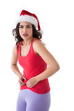 Festive fit brunette pinching her stomach Stock Photos